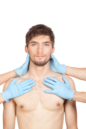 hands in blue gloves hold attractive young male face