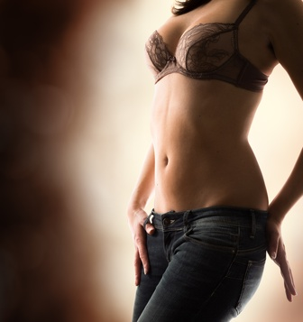 sensual woman in bra and jeans - darkness